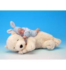 O bebé espreguiça-se no urso